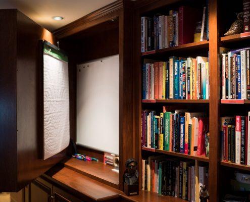 hidden whiteboard in custom cabinetry